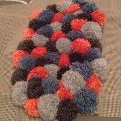 Pom Pom rug in the making