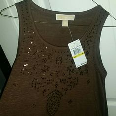 New michael kors tank Flash sale! Just reduced!!! Brand new with tags. Beautiful deep brown, embellished with brown sparkles. Perfect for layering, wonderful for all seasons. Little longer in back. MICHAEL Michael Kors Tops Tank Tops