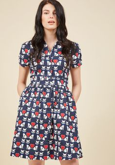 <p>Teach your students about signature style with this navy blue shirt dress - a ModCloth exclusive! Featuring ruched sleeves, a chic sash, and a light cotton blend printed with bowtie-clad white kitties - whose tails form bright red hearts - this pocketed A-line delights from the start of the semester to far beyond finals.</p>