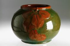 "Designer: 	Persson Hjelm, Hilma  Producer: 	Artists Studio  Year: 	1909 Swedish  Size: 	h.12,5cm/4,9"" w.18/7""  Object no: 	2498    Green glazed ceramic vase with applied and painted decoration. Incised signature and date 1909"