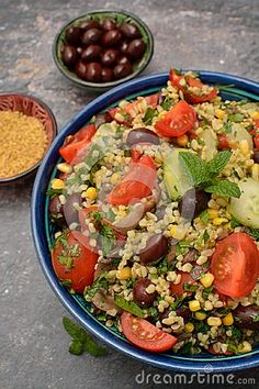 Photo about Closeup bulgur tabouleh salad with vegetables in a blue bowl. Top view on grey background. Image of delicious, chilled, food - 111797835 Blue Bowl, Gray Background, Top View, Cobb Salad, Stock Photos, Vegetables, Grey, Image, Food