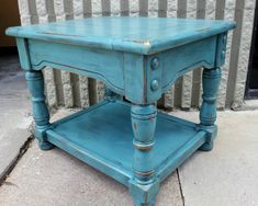 Chunky end table upstyled in distressed Sea Blue and Black Glaze.  From Facelift Furniture's End Table Collection.
