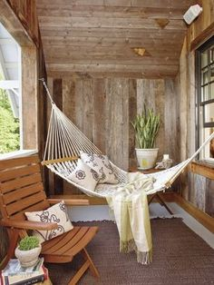 I don't know if those pins could support me but I'm loving the idea of a hammock out on the porch
