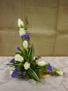 A traditional L shape arrangement, cost effective using only supermarket flowers. Helen Allen. Verdila.