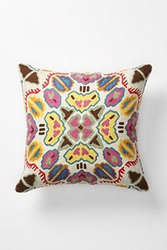 Embroidered cushion with tribal print. This kind of print would make a fantastic wall piece.