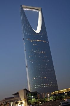 Riyadh: Anyone else think that this looks like a very large bottle opener ? Kingdom Tower in Riyadh, Saudi Arabia. photo: Richard Messenger >> Explores our Deals! Unusual Buildings, Interesting Buildings, Amazing Buildings, Modern Buildings, Futuristic Architecture, Beautiful Architecture, Art And Architecture, Innovative Architecture, Contemporary Architecture
