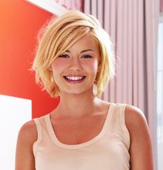 Elisha Cuthbert's blonde bob. http://beautyeditor.ca/2015/01/31/how-to-grow-out-pixie-cut