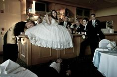 Funny wedding party photo at the bar with the groomsmen. Amber Malia Photography