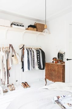 Small Closet Tip: Segregate long and short clothing to free up extra floor space under your short items