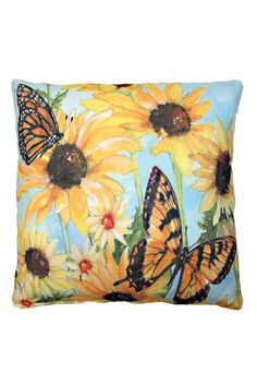 All the glory of nature's garden comes to you with this gathering of black eyed susans and two butterflies in the brightest oranges and yellows set against a blue sky. This indoor/outdoor pillow is printed from a watercolor painting by artist Sally Eckman Roberts. Made of 100% polyester, this pillow is fade and mildew resistant and has the soft feel of cotton. Removable zippered cover is machine washable.    Measures 18 x 18 inches.   Butterflies Blossoms Pillow by Magnolia Casual. Home…
