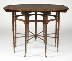 Octagonal center table by Edward William Godwin, British, ca. 1875. Made of rosewood and mahogany, with brass