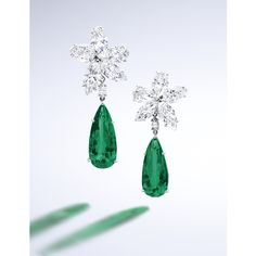 PAIR OF EMERALD AND DIAMOND PENDENT EAR CLIPS Each suspending on a pear-shaped emerald weighing 8.20 and 8.07 carats respectively, to a cluster surmount set with two pear-shaped and three marquise-shaped diamonds altogether weighing 14.63 carats, mounted in platinum, pendants detachable, cluster tops signed Cartier.
