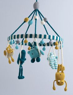 Freakin' adorable mobile! Coming soon from Knit A Monster Nursery by Rebecca Danger.