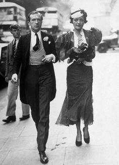 Photographer Cecil Beaton escorting Francis Doble (Lady Lindsey Hogg) to the wedding of Lord Herbert Equerry and Lady Mary Hope. London, July 1936.