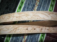 My first western belt with flowers and feather carving