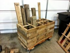 Mobile Pallet Wood Storage Unit made completely out of pallets!  Full build tutorial at FixThisBuildThat.com.