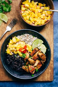 A quick and delicious recipe for homemade mojo chicken quinoa bowls. This cuban style chicken is served with mango salsa and black beans.