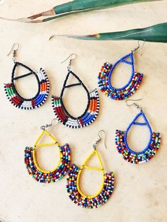 Beautiful Maasai Earrings with all the flirty summer vibes. Each pair is handmade by artisans in Africa. African Earrings, African Jewelry, Ethnic Jewelry, Ear Jewelry, Seed Bead Jewelry, Flower Jewelry, Jewlery, Unique Earrings, Bead Earrings