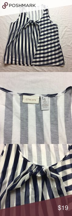 Chico's mesh ruffle sleeveless shirt tank top Chico's blue white striped mesh front ruffle sleeveless shirt tank top   Size: 3 (16 XL)   Body: 60% cotton, 40% modal; Front overlay: 100% nylon   Machine washable   Approx measurements: armpit to armpit – 20 1/2 inches; length – 26 ½ inches;   Gently used  – see pictures Chico's Tops Tank Tops
