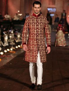Maroon sherwani with heavy zari work looks indeed regal | sherwani designs | wedfine.com | wedding venue search portal | wedding guide | wedding inspiration | wedding blog |