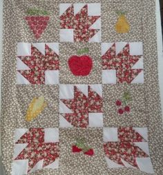 In the autumn fruits applique quilt I have used maple leaf patchwork blocks and applique blocks of simple fruits using autumn colours. Templates provided