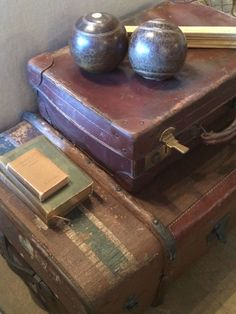 Well traveled luggage, perfectly worn books, well played lawn boules....makes me smile!