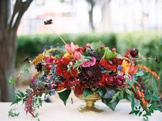 wedding proves rich, moody jewel tones are the ultimate autumn wedding color palette. See how this couple pulled off their big day without a neutral shade in sight! Marigold Wedding, Flower Wall Wedding, Floral Wedding, Wedding Flowers, Floral Centerpieces, Wedding Centerpieces, Wedding Bouquets, Floral Arrangements, Wedding Decorations