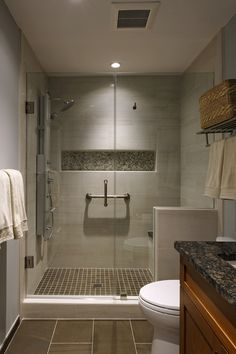 Creamy beige with warm brown porcelain and glass shower tile is current and timeless.