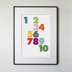This print is a play on numbers, colors + typography.