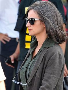 Penelope Cruz. Going gray naturally is beautiful. love the color of her blouse and jacket
