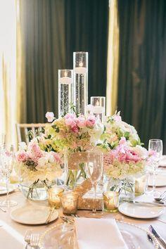 Absolutely beautiful centerpiece! #wedding #event #flowers #centerpiece #candles #laurenmichelleevents