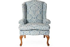 Classic wingback chair in blue ikat-patterned linen.