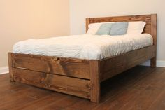 Hatfield Bed - A slightly slatted styled head and footboard set this piece off as a true one-of-a-kind! A small but carefully placed depth between the vertical and horizontal planks only add the intricate detail and creativity of this simple yet stunning bed.