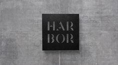 Kommigraphics - Harbor Suites Logo