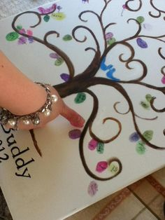 Great idea for a wedding guest book! Thumb print tree