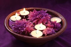 floating candels   Floating candles make beautiful decorations as the water enhances the ...