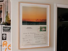Might be nice to get a collection of postcards from friends and family, frame them together, and stick on the old wall.