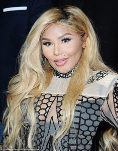 A month ago: Lil' Kim's face wasn't so 'pulled' during her outing at Brinks 5th Year Anniv...