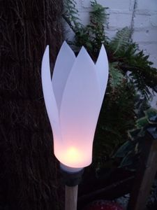 Reuse plastic bottles to make these easy, elegant DIY garden lights that cost almost nothing. From MOTHER EARTH NEWS magazine.