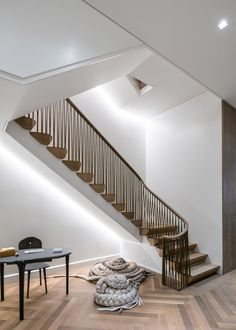 MKCA overhauls Upper East Side townhouse with custom staircase