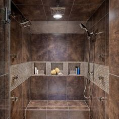 Master shower--I like how the accent tile wraps in line with the insets.  Also like separated insets, but large enough for lots of stuff.