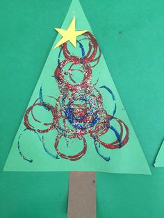 Christmas trees w toilet paper rolls and paint and glitter