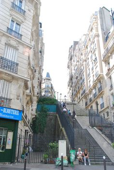 """Lucien set off down the two-hundred and forty-two steps to that very same boulevard into the neighborhood around Place Pigalle""  The stairs from Montmartre to Place Pigalle today. Lucien would have been coming from even higher on the butte than this picture shows. Pigalle Paris, Jaba, Picture Show, The Neighbourhood, Two By Two, Stairs, Street View, Travel Europe, Don't Forget"