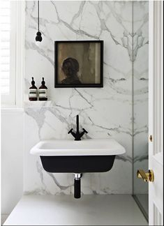 Marble use in the bathroom's wall, the pattern of the marble is perfectly match the black and white sink