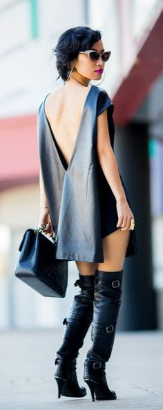 Edgy low back little black dress and over the knee boots