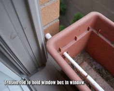 Tension rod to hold window box in window! Tension rod to hold window box in window! Indoor Window Boxes, Window Planter Boxes, Window Box Diy, Indoor Window Planter, Hanging Window Boxes, Hanging Baskets, Diy Flower Boxes, Window Box Flowers, Diy Flowers