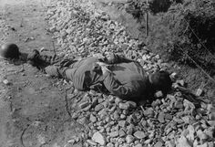 American Soldier Found Executed with Hands Tied, Korea by  Unknown Artist