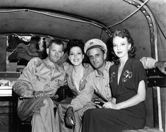USO entertainers Wini Shaw and Anna Lee in the back of a military vehicle during World War II. Probably North Africa c. 1943. USO Camp Shows, Inc. - NATOUSA | Flickr.com - gbaku
