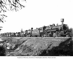 Polson Logging Company locomotives lined up on railroad track at company headquarters, known as Railroad Camp, near Hoquiam, ca. 1942
