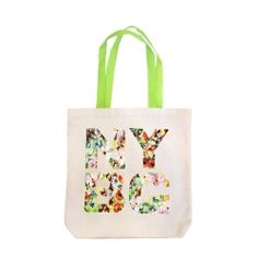 Featuring a floral NYBG watercolor print and bright green nylonweave handles, our canvas NYBG market tote is an instant classic. It is roomy enough to tote all of your essentials and sturdy enough to withstand countless trips to the farmer's market. Measures approximately 15 inches deep and 14 inches across.